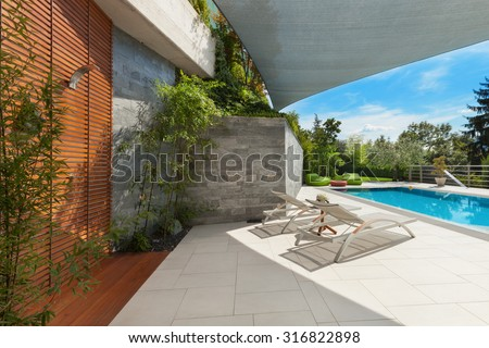 beautiful house, swimming pool view from the veranda, summer da - stock photo