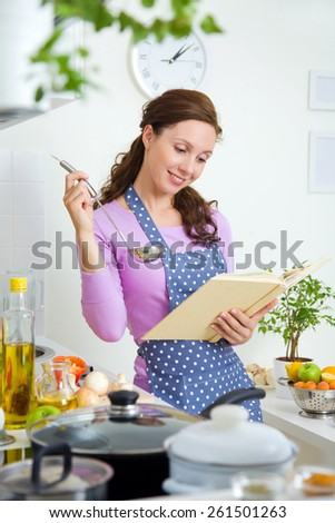 beautiful housewife preparing dinner in the kitchen with a prescription