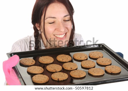 beautiful housewife smelling of cakes on white background