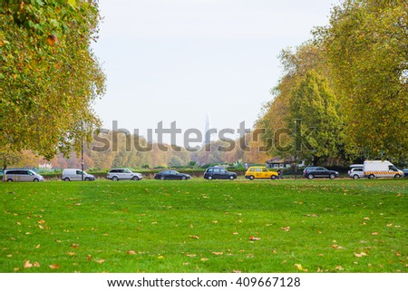 Beautiful Hyde park view over London traffic jam and Shard tower on the background. - stock photo