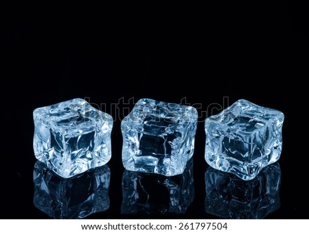 Beautiful ice cube on a black background - stock photo