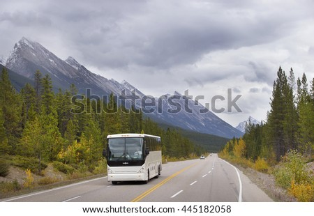 BEAUTIFUL ICE FIELD HIGHWAY, JASPER NATIONAL PARK, CANADA: September 14, 2015 - Tourist bus driving through snow peaked Ice Field HWY in Jasper NP. - stock photo