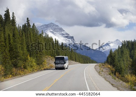 BEAUTIFUL ICE FIELD HIGHWAY, JASPER NATIONAL PARK, CANADA: September 14, 2015 - Tourist bus driving through snow peaked Ice Field HWY in Jasper NP.