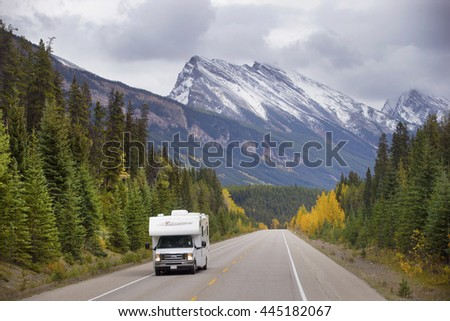 BEAUTIFUL ICE FIELD HIGHWAY, JASPER NATIONAL PARK, CANADA: September 14, 2015 - Tourist RV driving through snow peaked Ice Field HWY in Jasper NP.