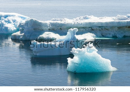 Beautiful icebergs drifting in Antarctic waters - stock photo