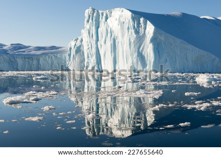 Beautiful Icebergs in Disko Bay Greenland around Ilulissat with blue sky - stock photo