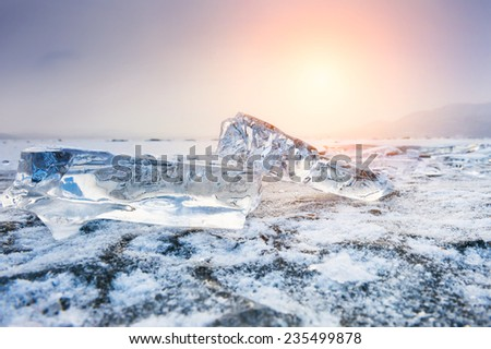Beautiful icicles at sunset. Winter landscape with ice on the lake. Soft focus. Creative toning effect - stock photo