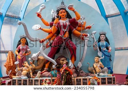 Beautiful idols of Hindu gods being worshipped during Durga Puja festival. - stock photo