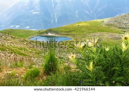 Beautiful idyllic Alps landscape with lake and mountains in summer, Switzerland  - stock photo