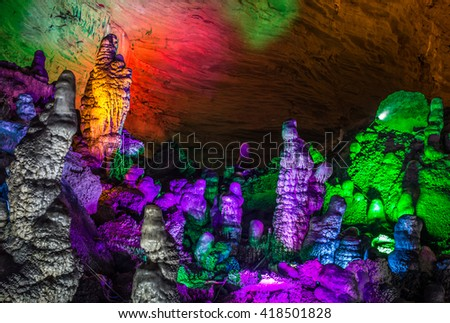 beautiful illuminated multicolored stalactites from karst Reed Flute cave. Guilin Guangxi  China - stock photo