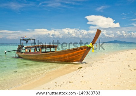 Beautiful image Longtail boat on the sea tropical beach. Andaman Sea,Krabi, Thailand