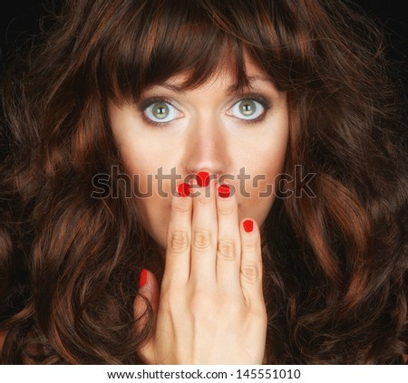 Beautiful Image of a Brunette woman On Black in studio - stock photo