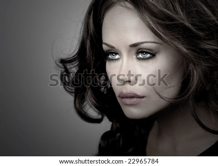 Beautiful Image of a Glamour Model On Grey - stock photo