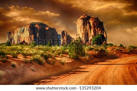 Beautiful Image of a Road through monument Valley - stock photo