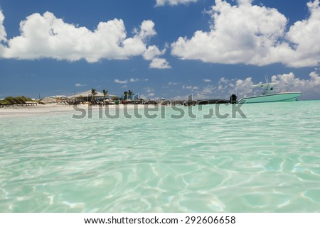 Beautiful image of boat along side of the beach - stock photo