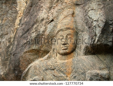 Beautiful image of carved Stone Buddha in Buduruvagala (UNESCO World Heritage Site), Buddhist Sculptures Rock - one of the most mysterious and interesting tourist sightseeing in Sri Lanka, South Asia - stock photo