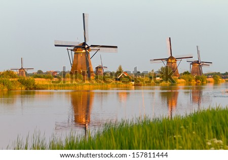 Beautiful image of the dutch windmills at Kinderdijk in the Netherlands. An UNESCO world heritage site - stock photo