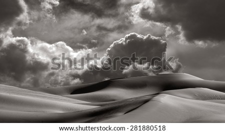 Beautiful Image of The Imperial Sand dunes California with a storm coming - stock photo