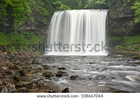 Beautiful image of waterfall in forest with stream and lush green foliage