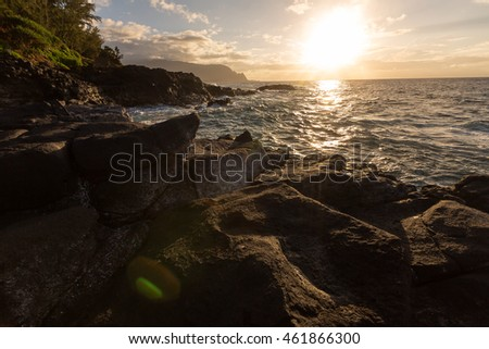 Beautiful images of ocean waves at sunset along the Queens Bath area of Kauai, Hawaii