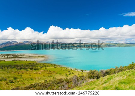 Beautiful incredibly blue lake Pukaki at New Zealand - stock photo