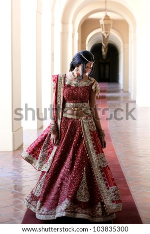 Beautiful Indian Bride in Cathedral Hallway on her wedding day