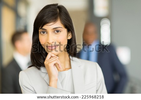 beautiful indian business woman looking at the camera - stock photo