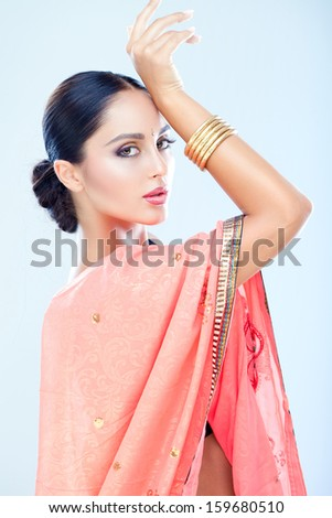 Beautiful Indian girl dancing - stock photo