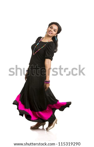 Beautiful Indian girl Dancing against white background. - stock photo