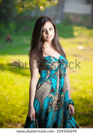 beautiful indian girl in nature - stock photo