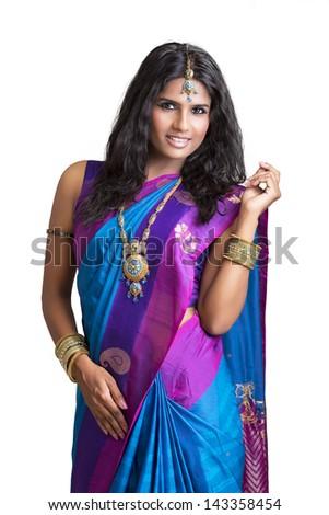 Beautiful Indian girl in traditional Indian sari. - stock photo