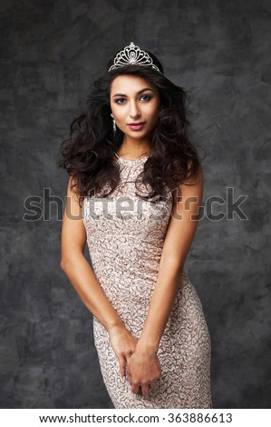 beautiful indian lady in fitting dress and diadem