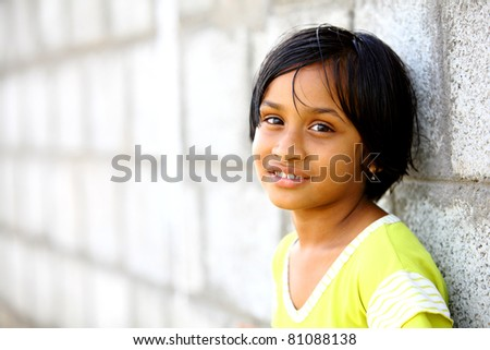 Beautiful Indian little girl smile face.