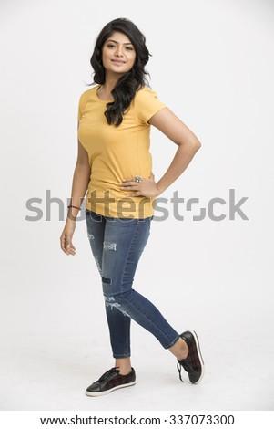 Beautiful indian model posing isolated on white - stock photo