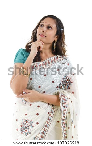 Beautiful Indian woman having a thought, isolated white background - stock photo