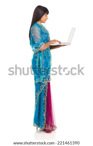 beautiful indian woman holding laptop computer on white background - stock photo