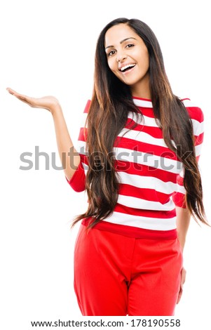 Beautiful Indian woman pointing showing copyspace white background - stock photo