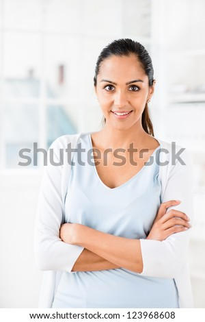 Beautiful Indian woman portrait happy smiling at home - stock photo