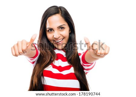 Beautiful Indian woman smiling happy thumbs up white background - stock photo