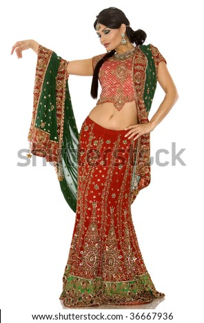beautiful indian woman wearing bridal outfit on white - stock photo