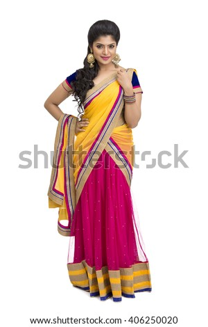 Beautiful Indian young girl in half sari standing over white background. - stock photo