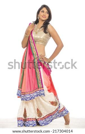 Beautiful Indian young girl in traditional lehenga choli. - stock photo