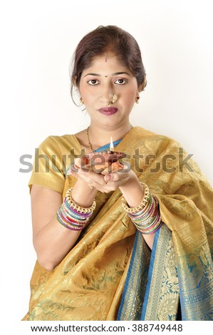 Beautiful Indian young girl posing in traditional Indian saree on white background.  - stock photo