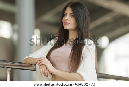 beautiful indoor portrait. brunette woman with long healthy hair. Focus on woman. Blurred background