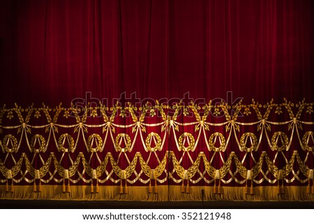 Beautiful Indoor Theater Stage curtains With Dramatic Lighting. - stock photo