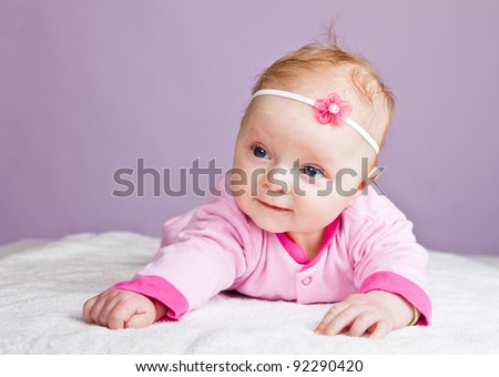 Beautiful infant baby girl in pink