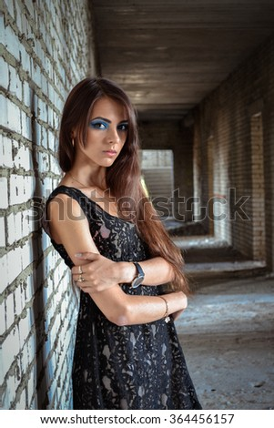 Beautiful,innocent,young,attractive,lonely,upset girl,woman,teenager dirty,interior,grunge,wall,background,ruin,desolate,destruction,urban,hall,nobody,rusty,manufacturing,abandoned,no freedom,exist.