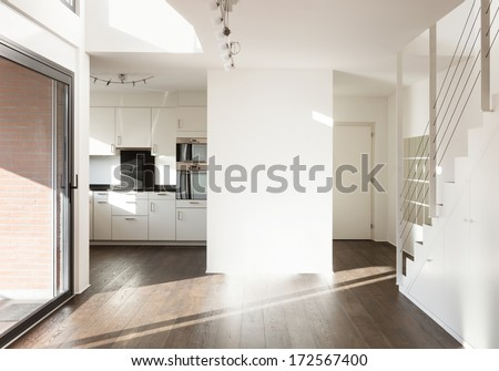 beautiful interior of a new apartment, wide empty living room - stock photo