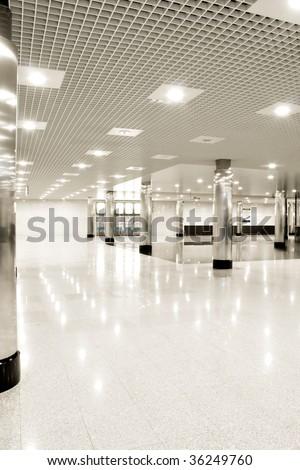 beautiful interior of futuristic corridor in airport - stock photo