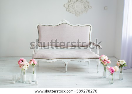 beautiful interior - white sofa and flowers in vases - stock photo